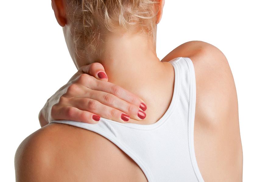 Girl feeling shoulder, in pain.