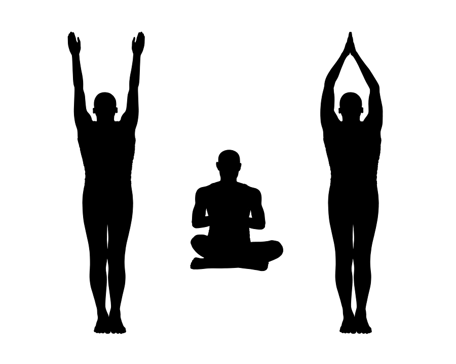 Silhouette of people stretching taller in mountain pose