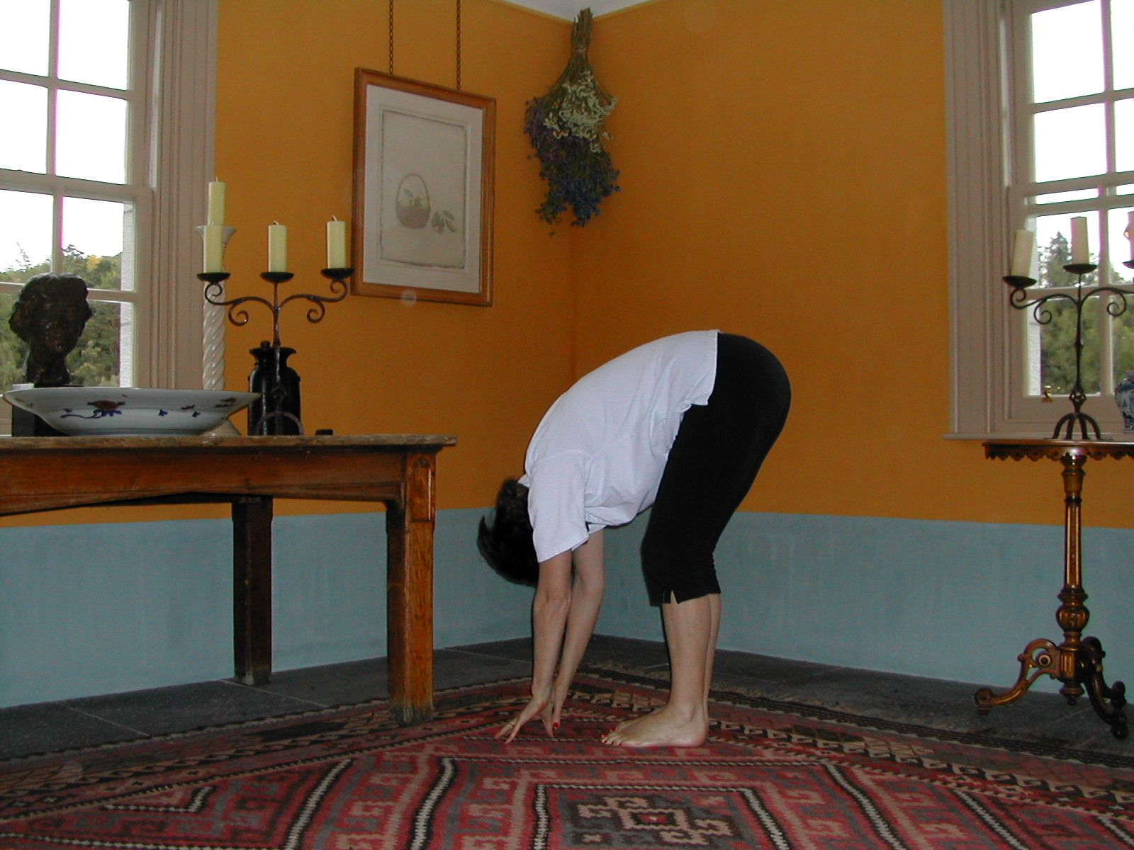 Forward Bending in Standing is exercise 17 in Sarah Key's list of the best yoga for lower back pain