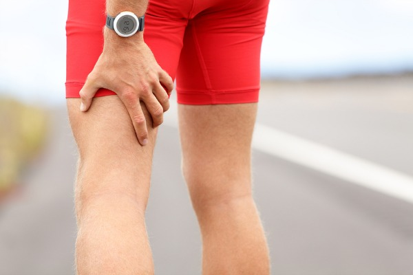 Man gripping leg with sciatica pain