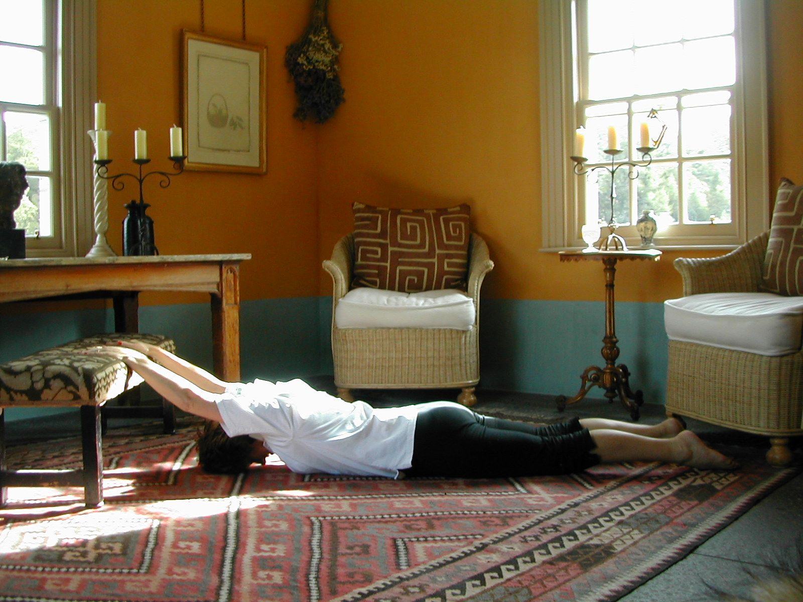 Shoulder Hangs in Prone are exercise 16 in Sarah Key's list of the best yoga for lower back pain
