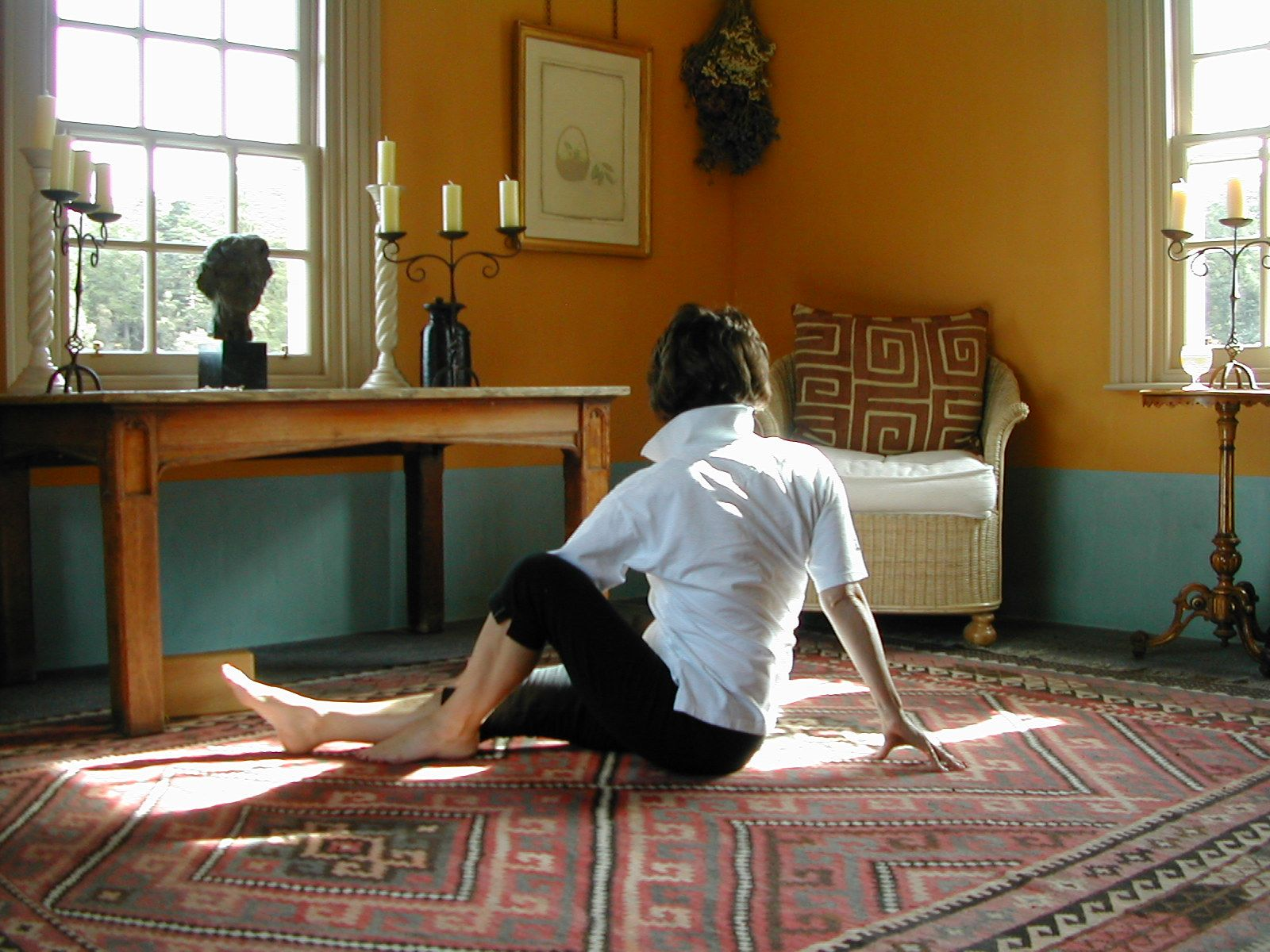 Sitting Floor Twists Right are part of exercise 12 in Sarah Key's list of the best yoga for lower back pain
