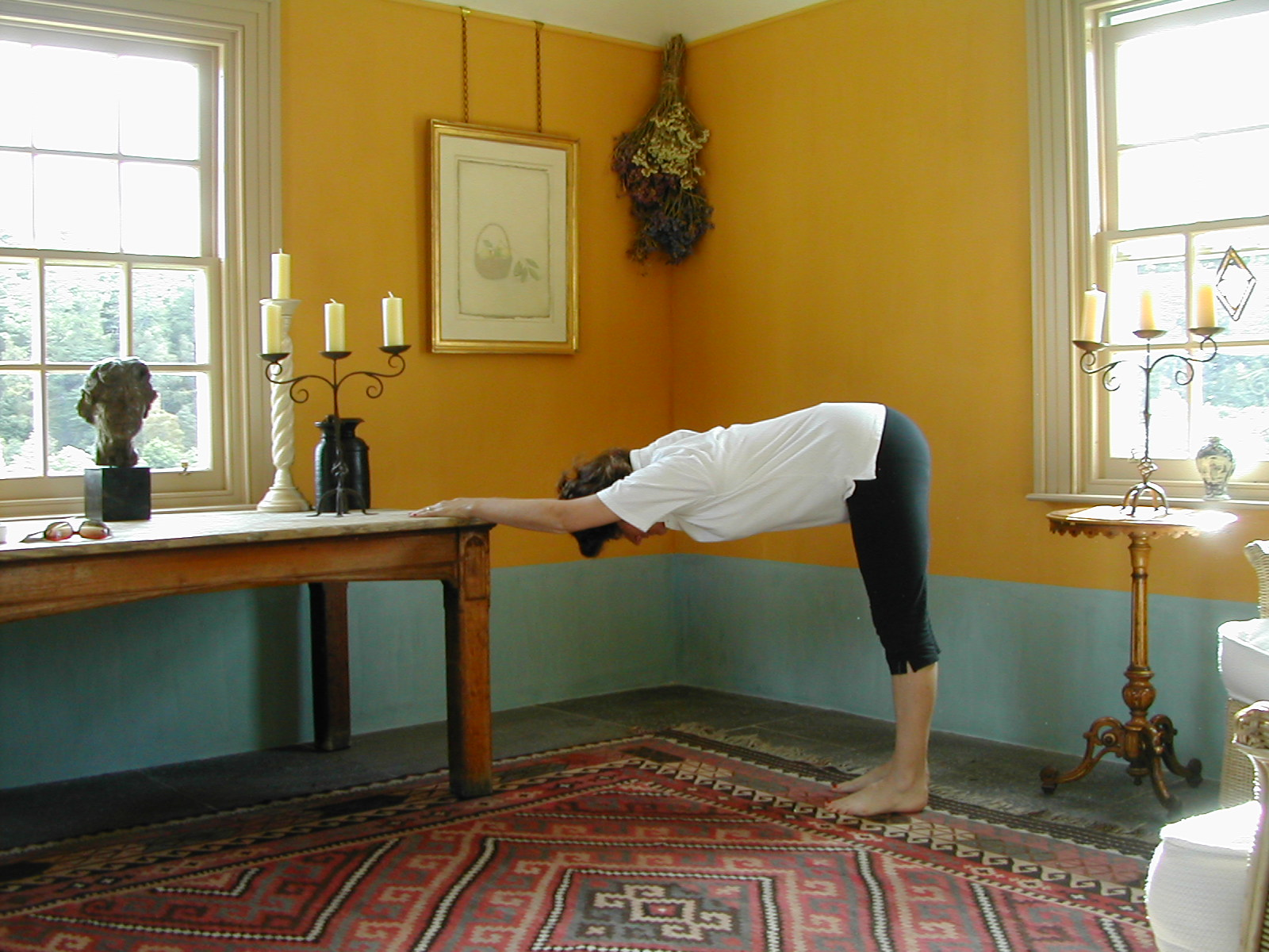 The Table Stretch lengthens the spine and loosens the spinal nerves caught and matted in adhesions