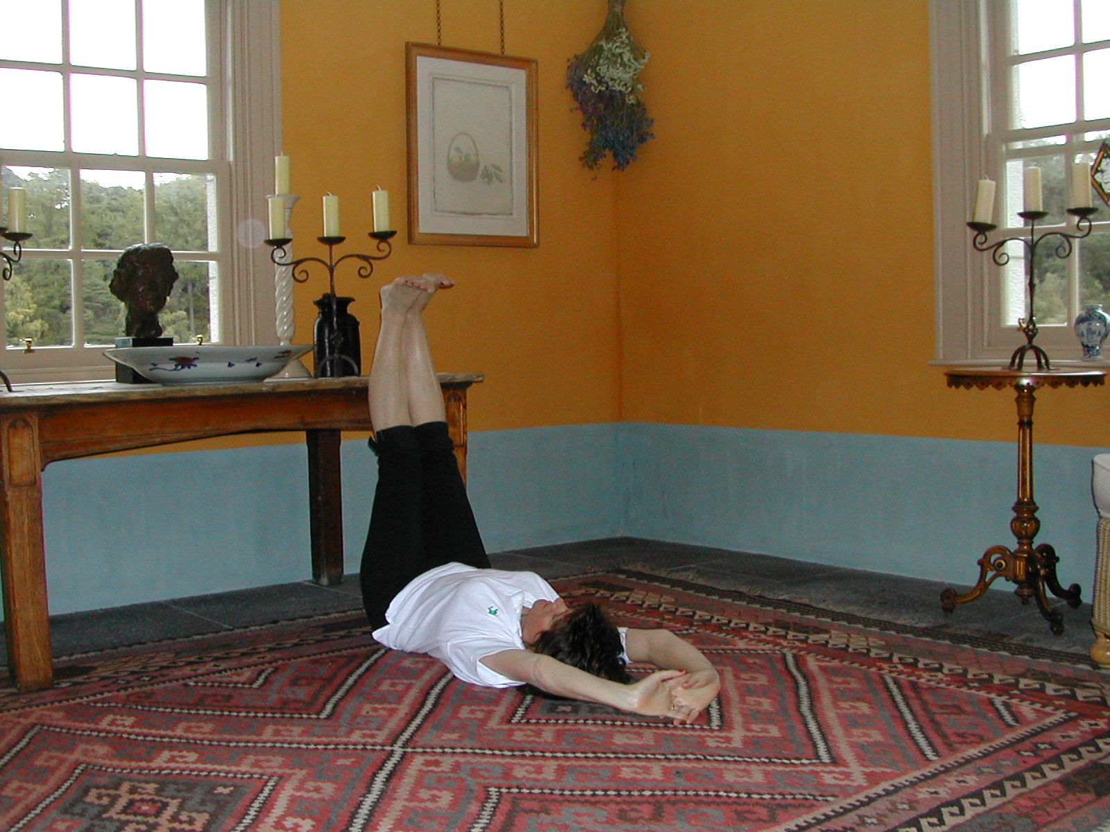 Right Angle Stretch is exercise 1 in Sarah Key's list of the best yoga for lower back pain