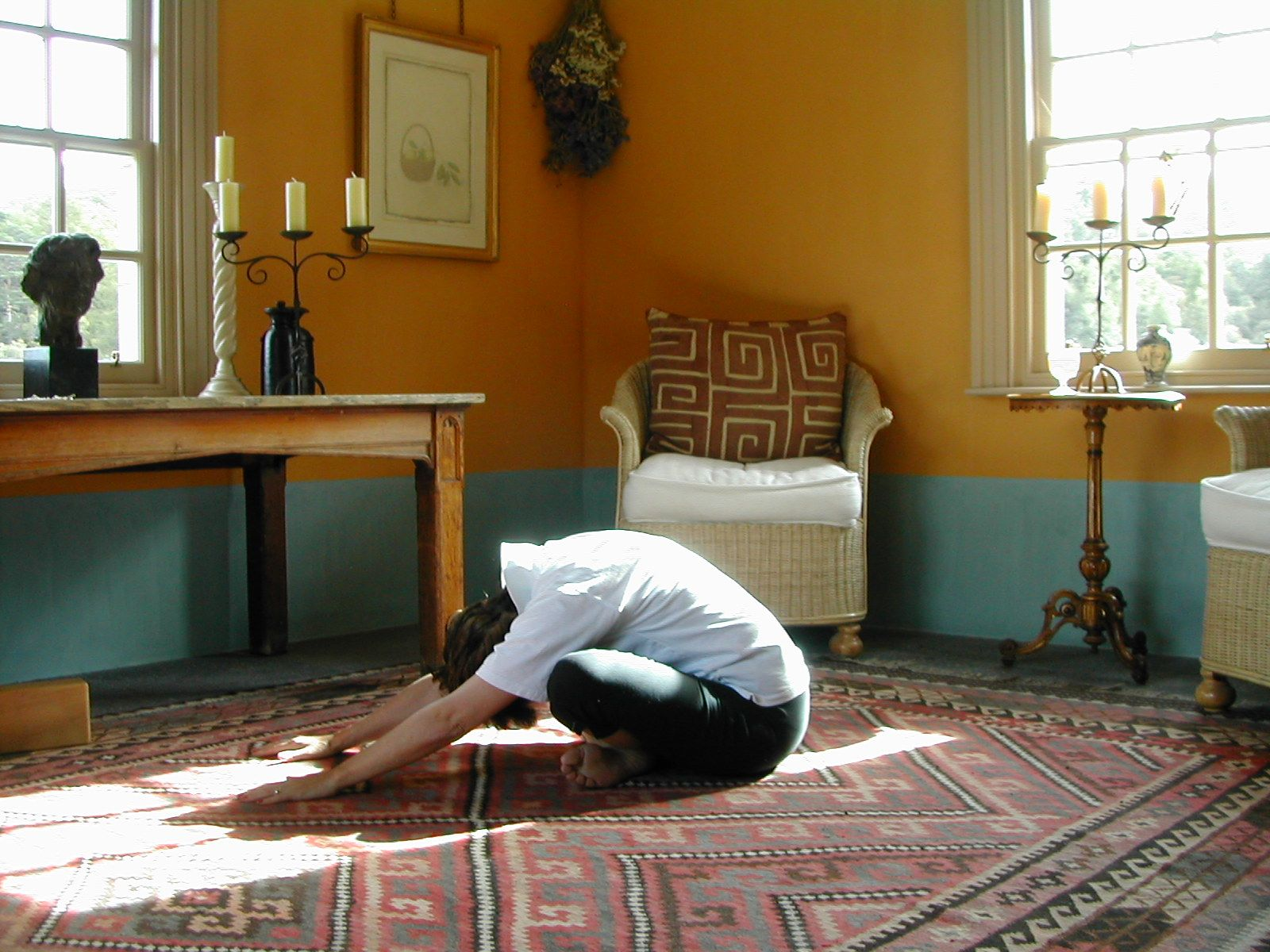 The Cross-Legged Leaning Forward Stretch  is exercise 11 in Sarah Key's list of the best yoga for lower back pain