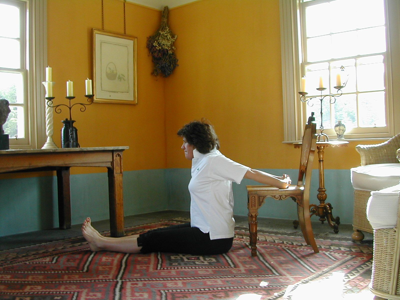 Shoulder Extension in Sitting are exercise 15 in Sarah Key's list of the best yoga for lower back pain
