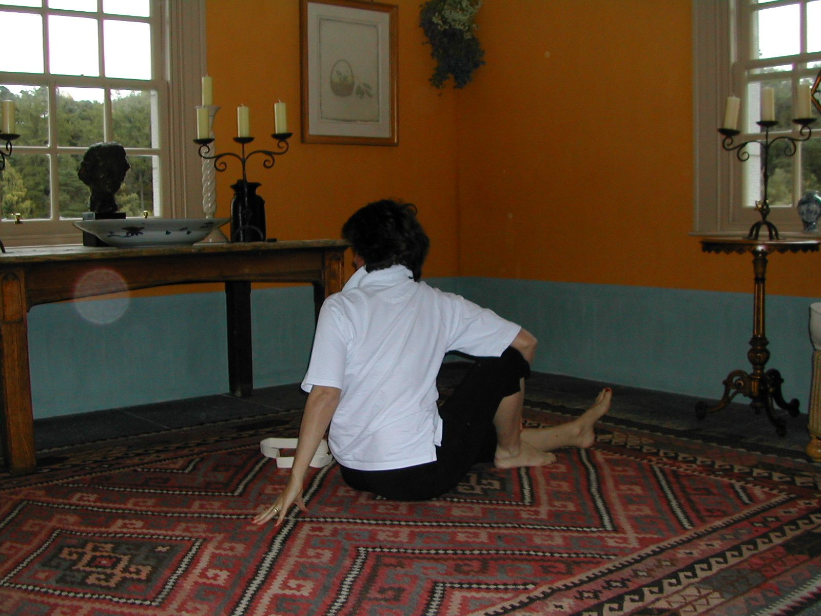 The Sitting Floor Twists Left are part of exercise 12 in Sarah Key's list of the best yoga for lower back pain